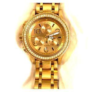 Nixon gold watch with diamonds
